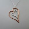 Nested Hearts Pendant in Sterling Silver and Copper