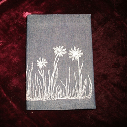 Lined notebook in embroidered cover.