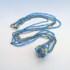 Lampwork glass bead with a sea theme on long necklace on shades of blue