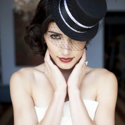 Black veiled mini top hat with black/white ribboning and feathers