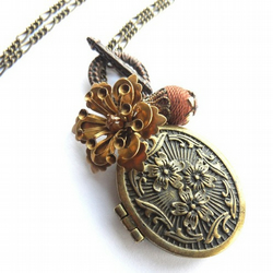 Bronze locket and brass flower necklace