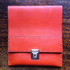 Burnt orange slimline leather pencil case perfect to sit inbetween books
