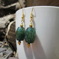 Green faceted agate barrel earrings.