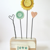 SALE - Clay painted flowers and hearts on wooden block 'love'