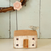Little wooden house with clay flower and bird