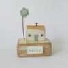 Little wooden house with blue clay flower 'happy'