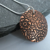 Floral design copper pendant