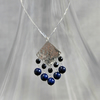 Fringed hammered silver and blue lapis pendant
