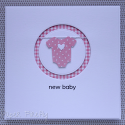 Handmade new baby girl card with babygro