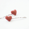 Pair of dark pink porcelain love heart hairpins