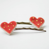 Pair of red love heart porcelain bobby pins with gold dots