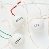 Personalised ceramic Christmas bauble. Free UK shipping.