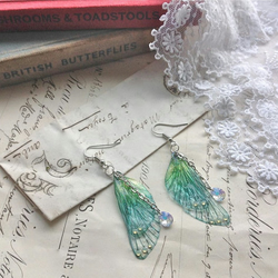 "Rather pretty Small ""Blue rainbow Faerie wing earrings"""