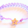 Lilac beaded bracelet with wooden star button.