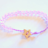 Pink and lilac beaded bracelet with wooden star button.