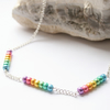 Rainbow beaded silver necklace.