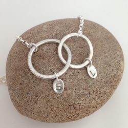 'Mella' - entwined circles with hand stamped tags