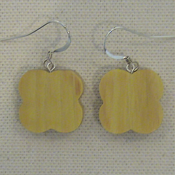 Flower shaped earrings in Osage Orange
