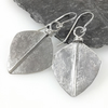 Large silver leaf spear earrings