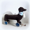 Large velveteen Daschund sausage dog on vintage Meccano wheels