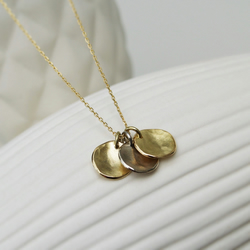 Three 18ct yellow and white gold small 9mm organic disc pendants and chain
