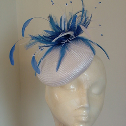 White Straw Pill Box Hat With A Royal Blue And White Feather Flower