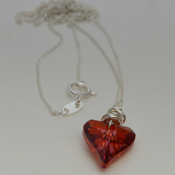 Red Swarovski heart with sterling silver.