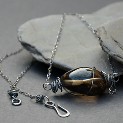 Necklace of sterling silver and a smoky quartz nugget.