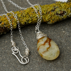Sage green and earthy brown jade pendant.