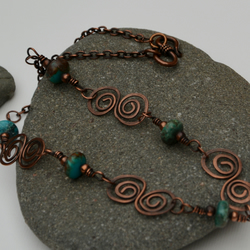 Turquoise and copper spiral necklace.