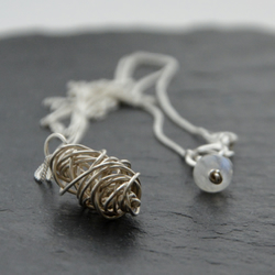 Wire wrapped sterling silver bead necklace.