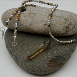 Grey, gold and silver necklace with smoky quartz.