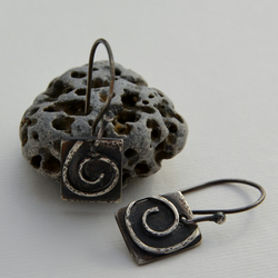 Hammered sterling silver spiral earrings.
