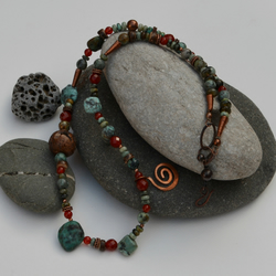 Gemstone necklace in grey, green, burnt orange and copper.