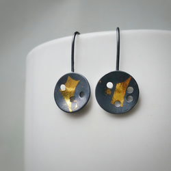 Textured Disc Silver and black Drop Earrings with little gold detail.