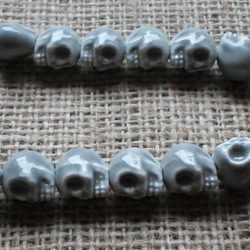 Strand of 15 Ceramic Candy Skulls