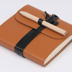 Leather pocket notebook with pencil