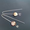 Long silver and pearl earrings