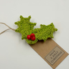 Crochet Holly Brooch on a Gift Tag