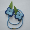 Pale blue flower hair elastics