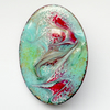 enamel brooch - scrolled red, green and white over turquoise