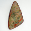 brooch: triangular - scrolled red, green, black on dove grey over clear enamel