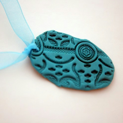 Bright Blue Polymer Clay Pendant on Blue Ribbon