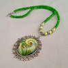 Green bead necklace with swirly green glass pendant - 1002050S