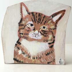Painting on reclaimed wood of a tabby cat