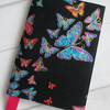 A6 Rainbow Butterflies on Black Reusable Notebook Cover