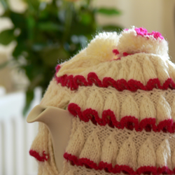 Strawberries and cream hand knitted ruffle tea cosy with pompoms