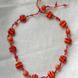 Knotted string necklace of glass, jade and carnelian amber beads