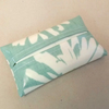 Turquoise tissue holder with daisy pattern, tissues included