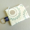 Mini coin purse in cream with zig zag pattern, key ring